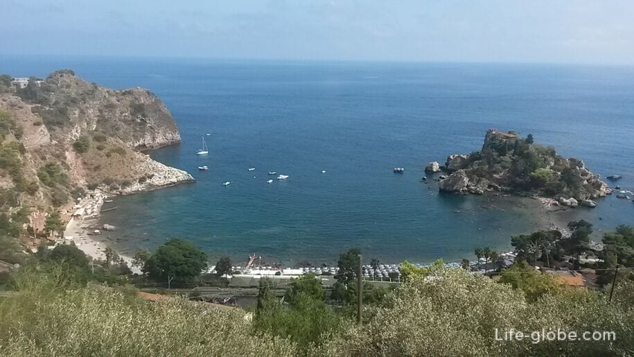 View of the beach and the island of Isola Bella, Taormina