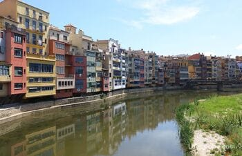 Houses and bridges of the Onyar River in Girona - business cards of the city