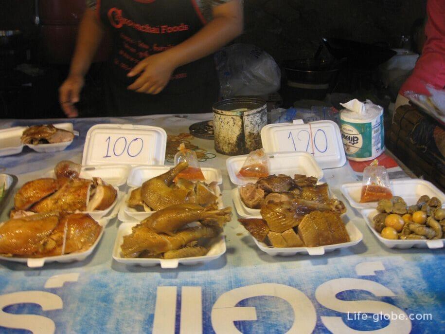 Курица на ночном рынке на Кароне, Таиланд