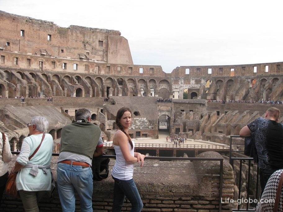 tourists at coliseum, italy rome